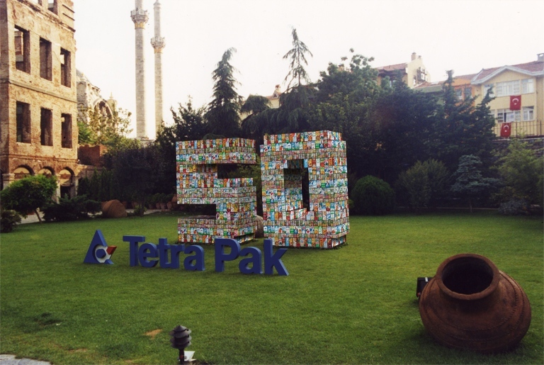 """50"" figure made with Tetra Pak's local brands' packages (2002)"